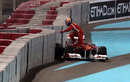 Fernando Alonso leaps from his car after spinning off at turn one