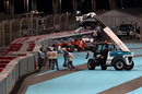 Fernando Alonso's Ferrari gets craned away after spinning off at turn one