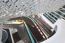 Daniel Ricciardo passes underneath the Yas Hotel