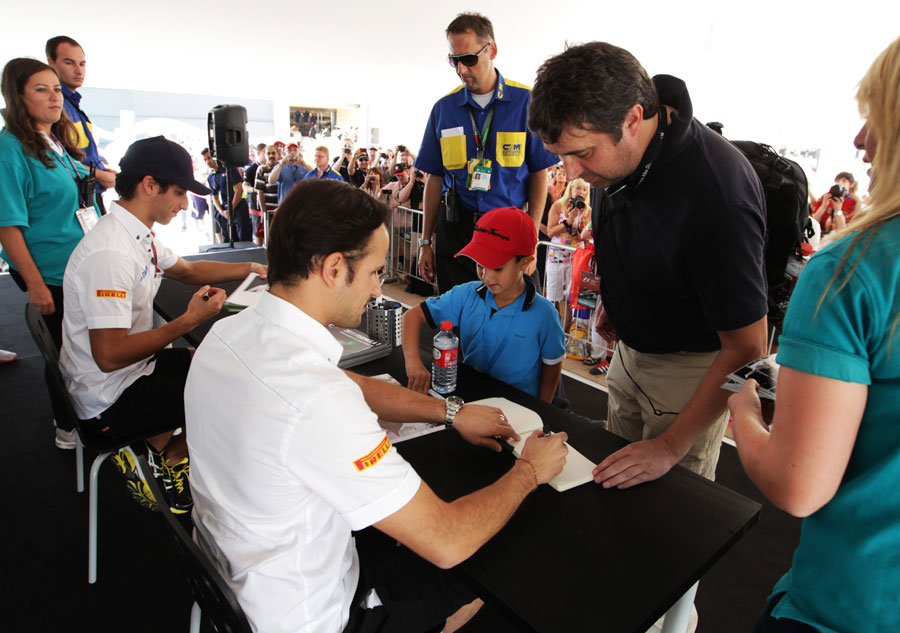 Tonio Liuzzi and Daniel Ricciardo at an autograph signing session on Saturday morning