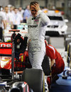 Michael Schumacher takes a look at the McLaren in parc ferme
