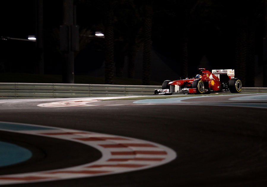 Fernando Alonso picks his way through the shadows