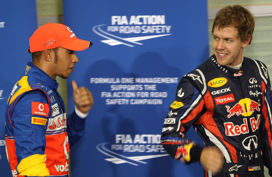 Lewis Hamilton and Sebastian Vettel chat in parc ferme