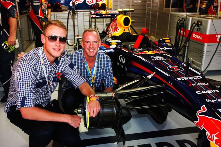 Stuart Broad and Norman Cook enjoy the surroundings of the Red Bull garage