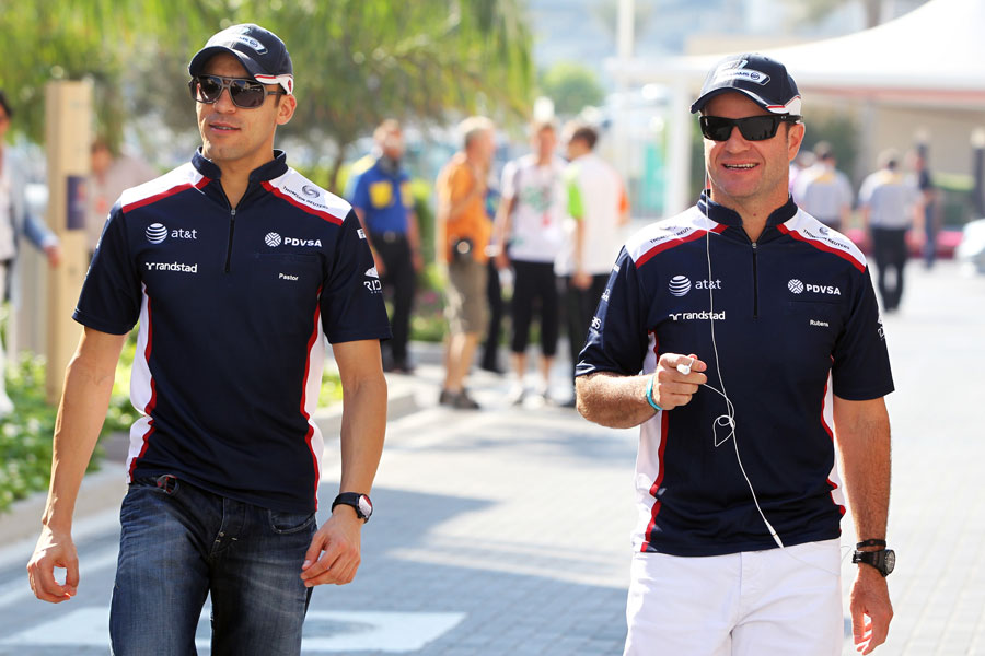 Pastor Maldonado and Rubens Barrichello in the paddock before the race