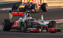 Mark Webber closes in on Jenson Button early in the race
