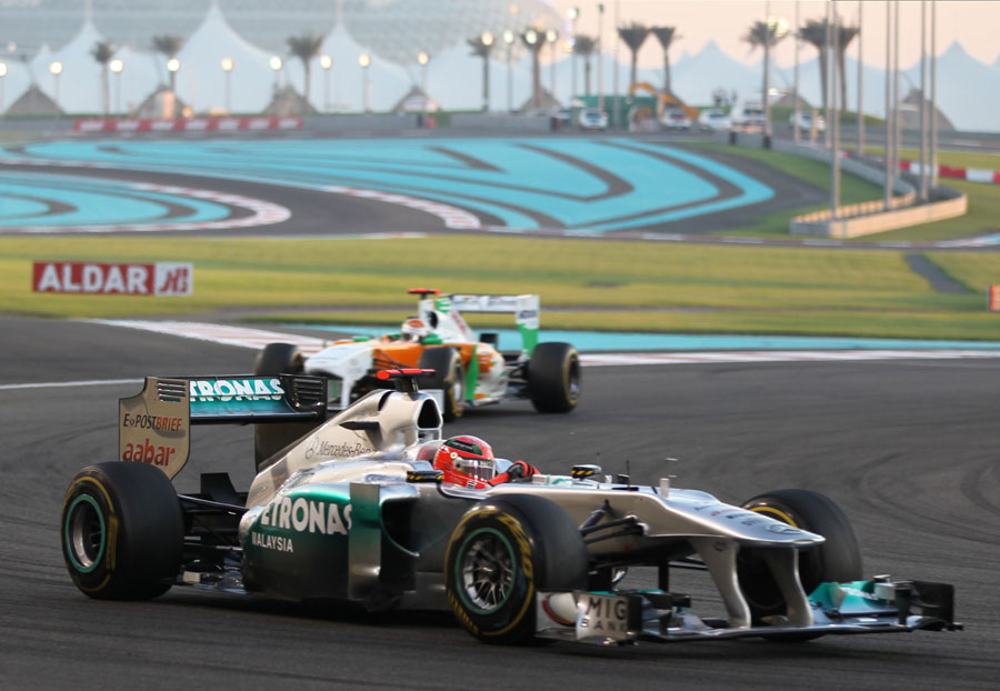 Michael Schumacher leads Adrian Sutil in to turn seven