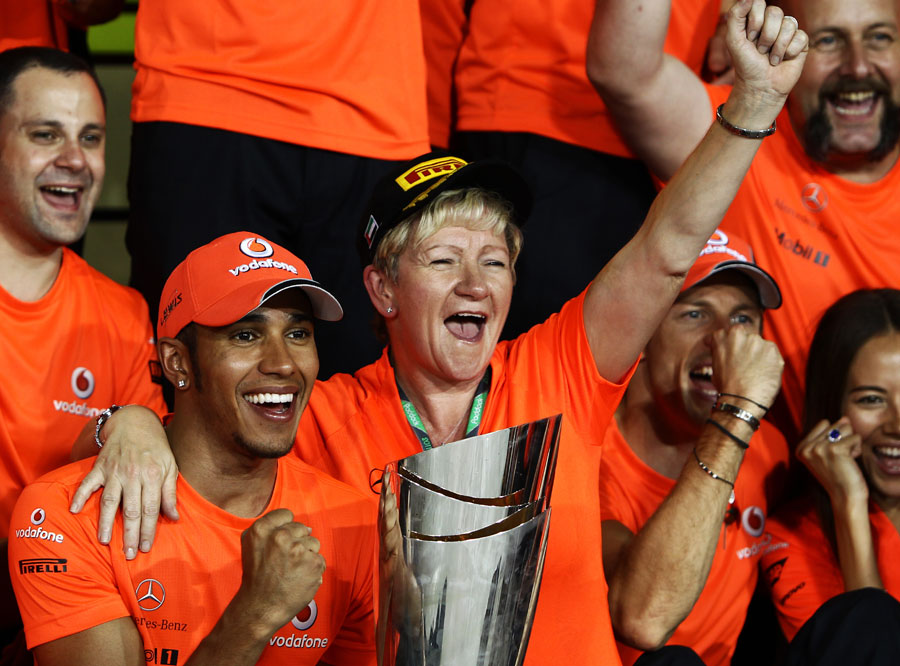 Lewis Hamilton celebrates with his mum Brenda and the rest of the McLaren team