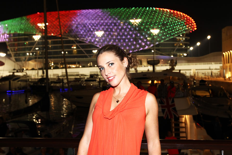 A VIP poses in front of the Yas Hotel
