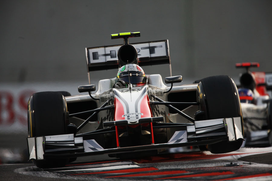 Tonio Liuzzi hops the kerbs in the HRT