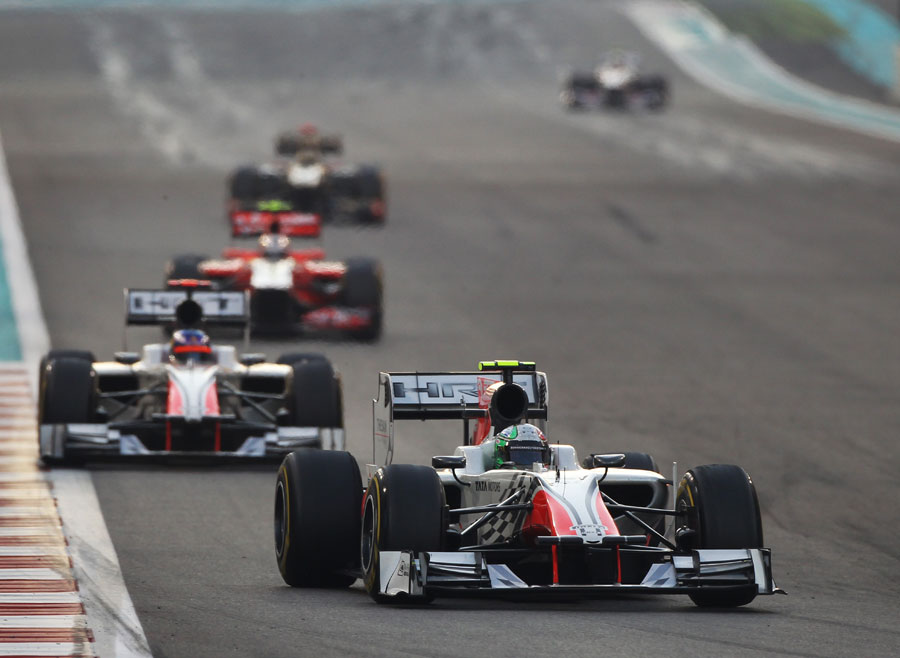 Tonio Liuzzi leads a group of backmarkers