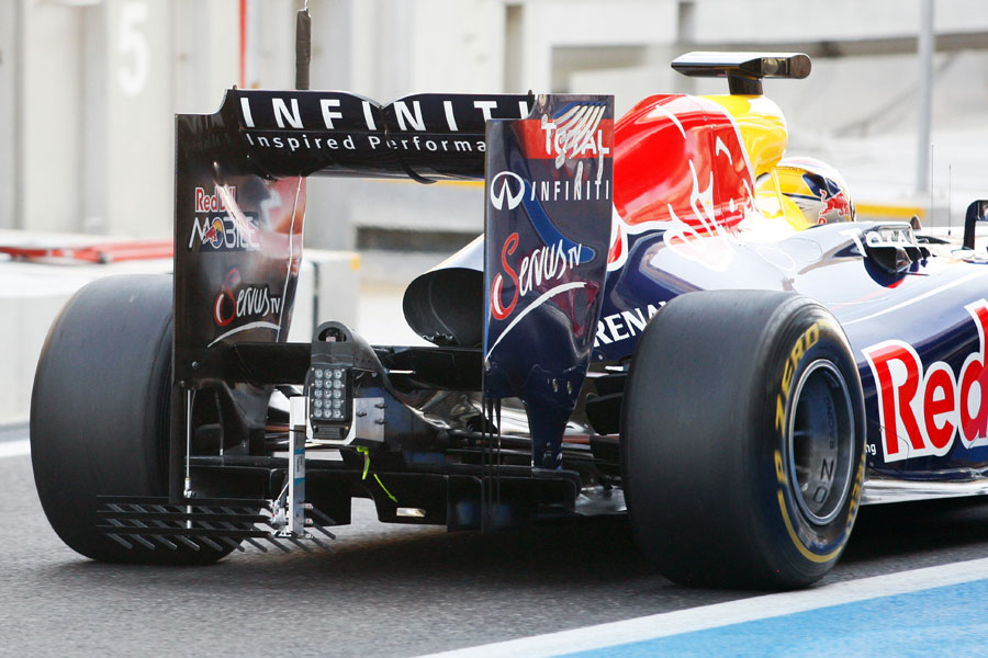 Jean-Eric Vergne heads down the pit lane with a measuring device on the rear of the RB7