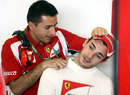 Jules Bianchi receives treatment on his neck in the Ferrari garage
