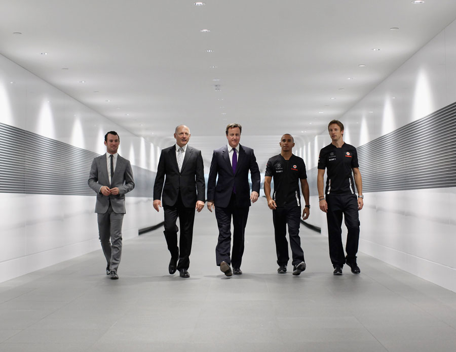 British Prime Minister David Cameron with Mark Cavendish, Ron Dennis, Jenson Button and Lewis Hamilton during a visit to the McLaren Technology Centre