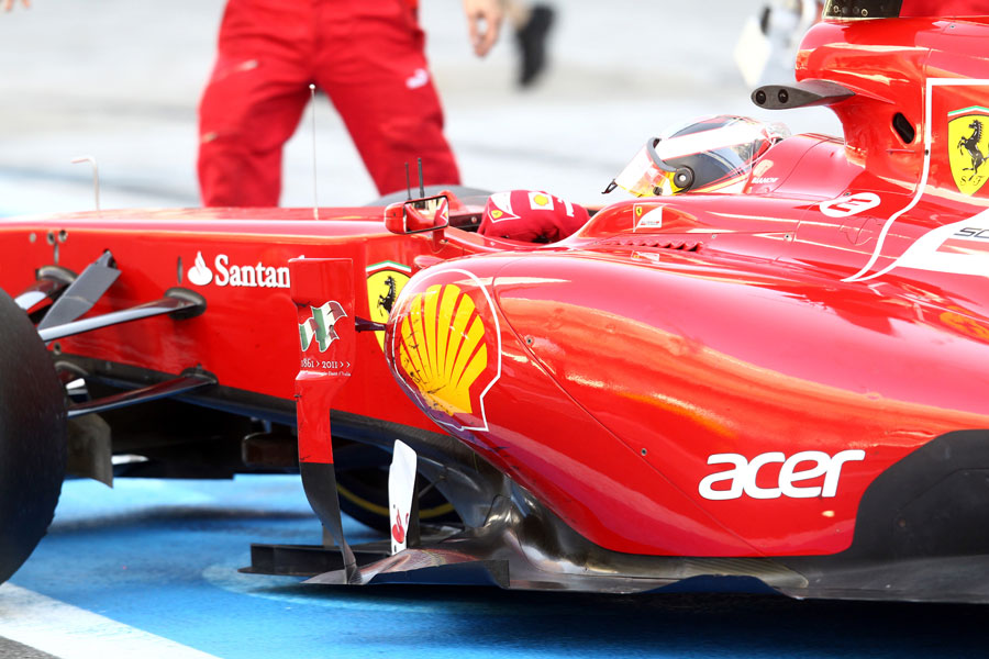 Jules Bianchi pulls up outside the Ferrari garage