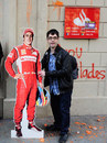 Image problem? A student poses with a cut out of Fernando Alonso outside  a bank during a protest against education cuts in Barcelona