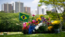 A Brazilian flag waves next to floral tributes on the grave Ayrton Senna