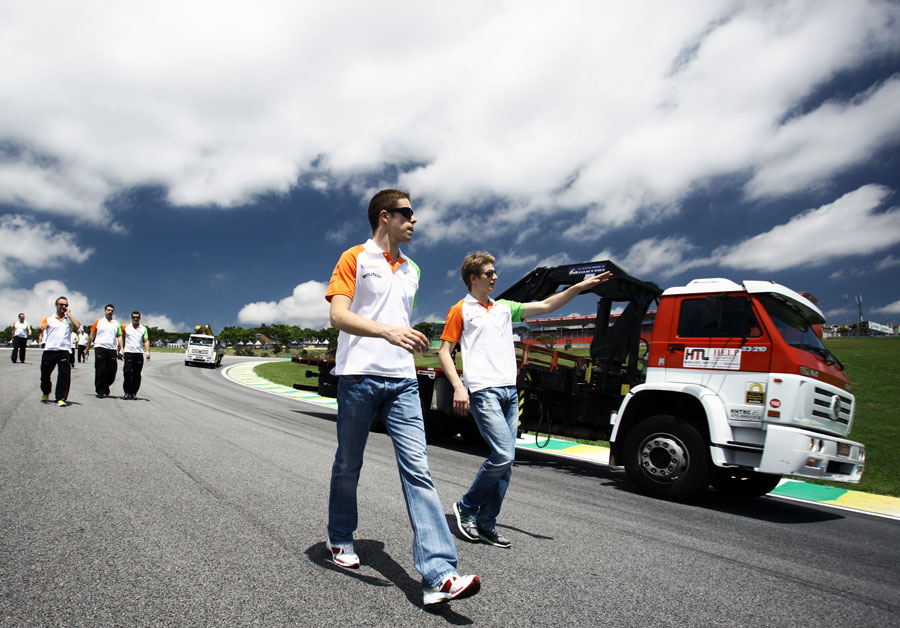 Paul di Resta and Nico Hulkenberg walk the track