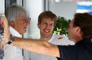 Bernie Ecclestone, Sebastian Vettel and Christian Horner chat in the paddock
