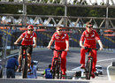 Felipe Massa cycles the track with race engineer Rob Smedley