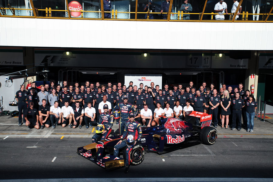 The Toro Rosso team poses for an end of season photo