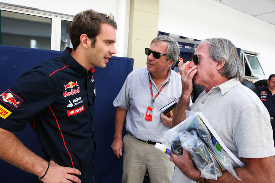 Jean-Eric Vergne chats to Jacques Laffite in the paddock ahead of his latest FP1 appearance