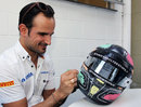 Tonio Liuzzi colours in his new helmet design for this weekend's race