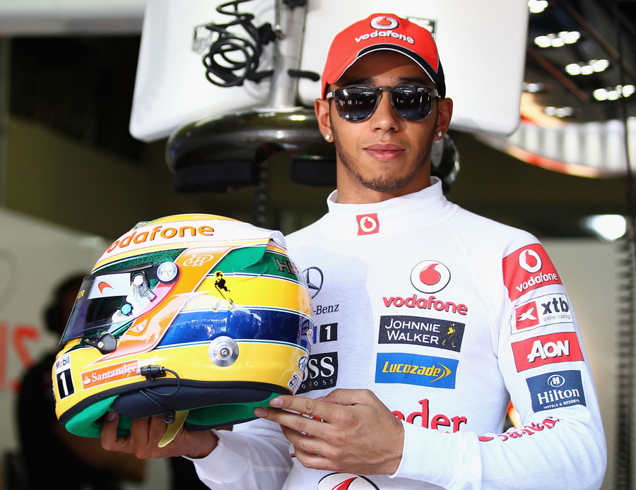 Lewis Hamilton shows off his special Ayrton Senna helmet design