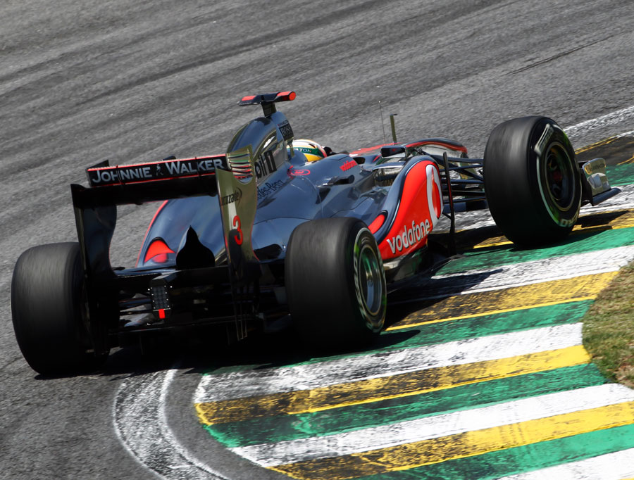 Lewis Hamilton rides the kerbs in his McLaren