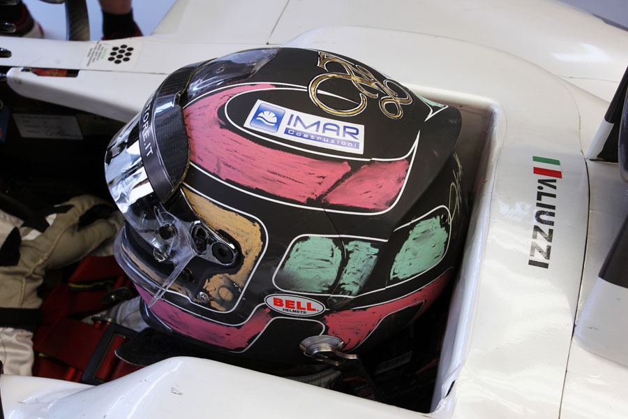 Tonio Liuzzi waits in the HRT garage sporting a chalky helmet design