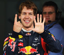 Sebastian Vettel celebrates his 15th pole position of the season