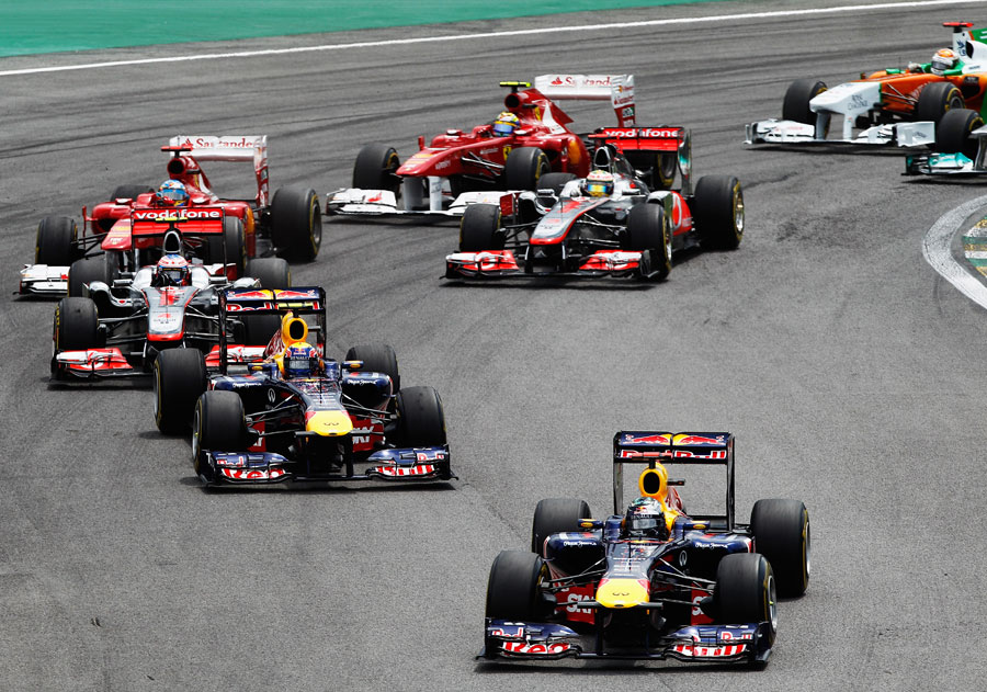 Sebastian Vettel leads the pack away at the start
