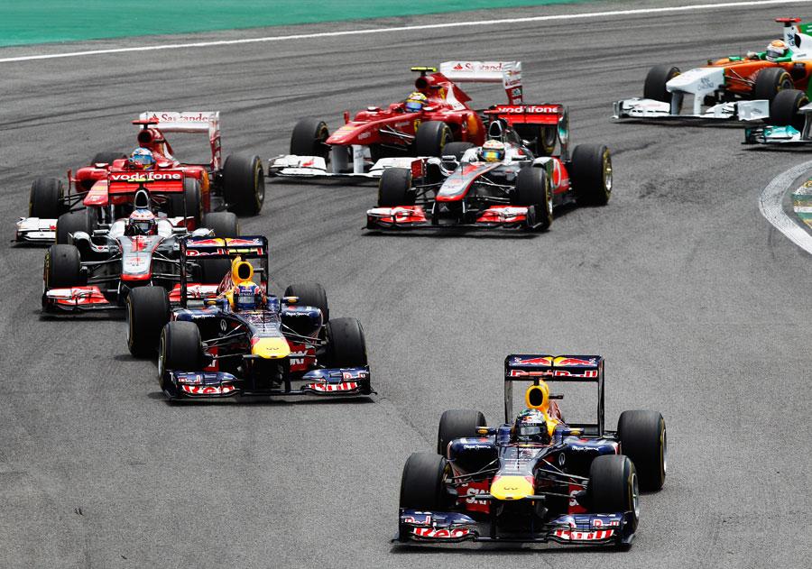 Sebastian Vettel leads the pack away at the start
