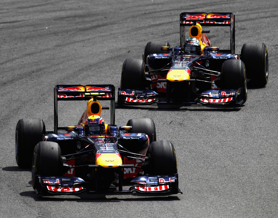 Mark Webber passes Sebastian Vettel in turn one
