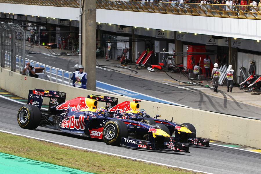 Mark Webber passes Sebastian Vettel into turn one to take the lead