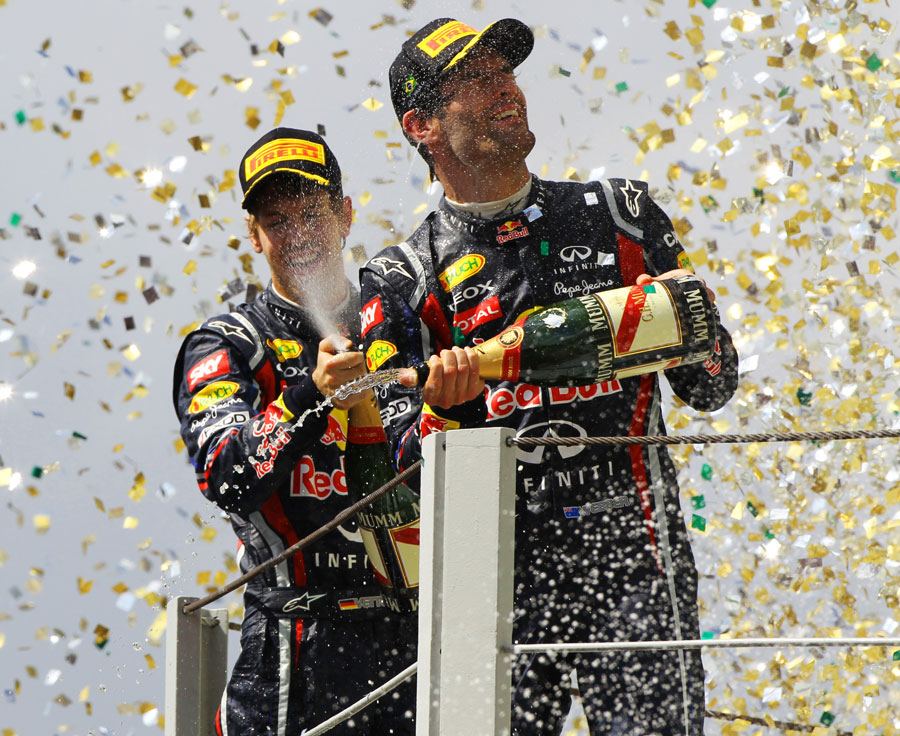Mark Webber and Sebastian Vettel celebrate a Red Bull one-two on the podium