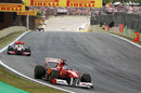 Fernando Alonso leads Lewis Hamilton in to turn one