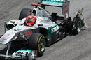 Michael Schumacher heads for the pits with a puncture