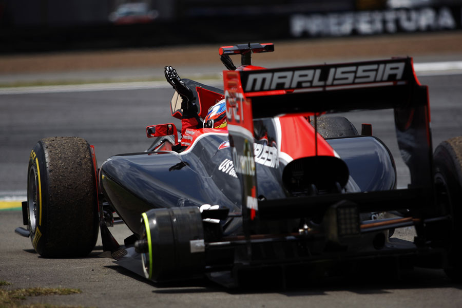 Timo Glock gets out of his three-wheel Virgin