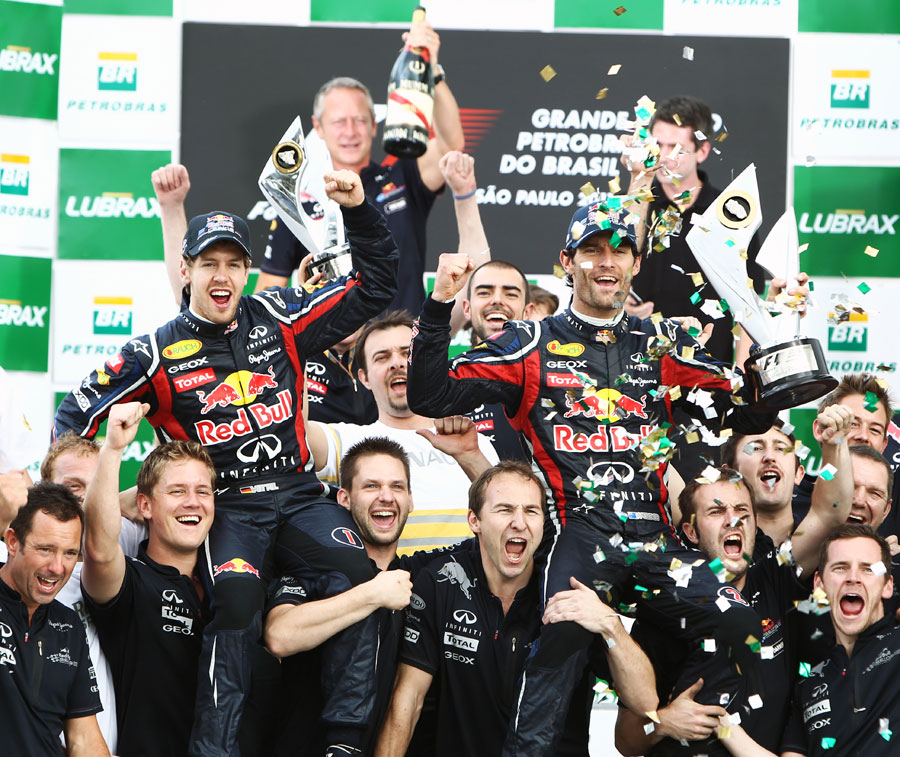 Mark Webber and Sebastian Vettel celebrate a Red Bull one-two with the team on the podium
