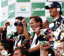 Mark Webber, Christian Horner and Sebastian Vettel celebrate a Red Bull one-two on the podium