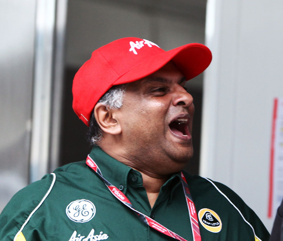 Tony Fernandes celebrates Lotus' tenth place in the constructors' championship
