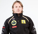 Kimi Raikkonen poses in his new Lotus Renault team kit