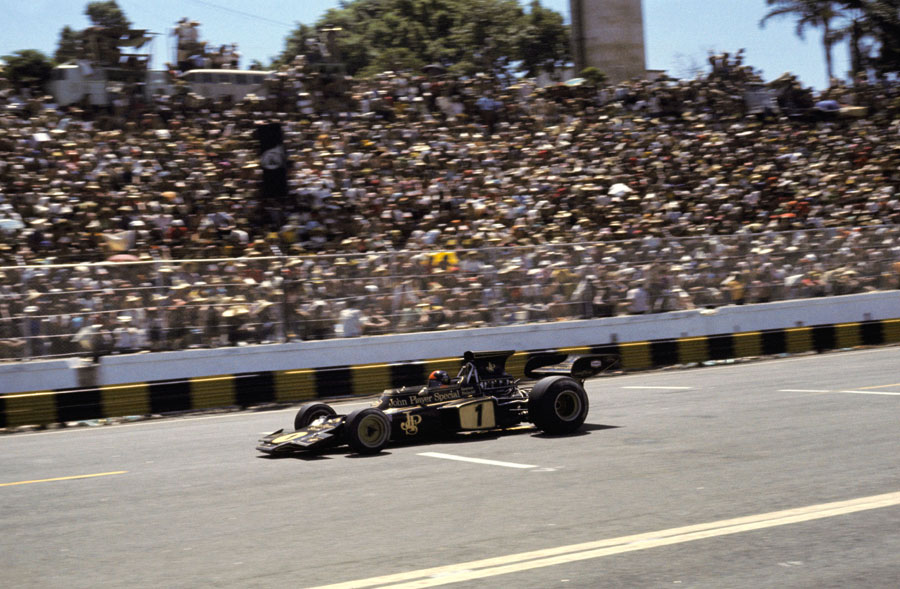 Emerson Fittipaldi passes the enthusiastic home crowd in the main grandstand