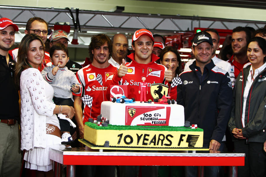 Felipe Massa receives a cake to mark 100 grand prix starts for Ferrari and ten seasons in Formula One