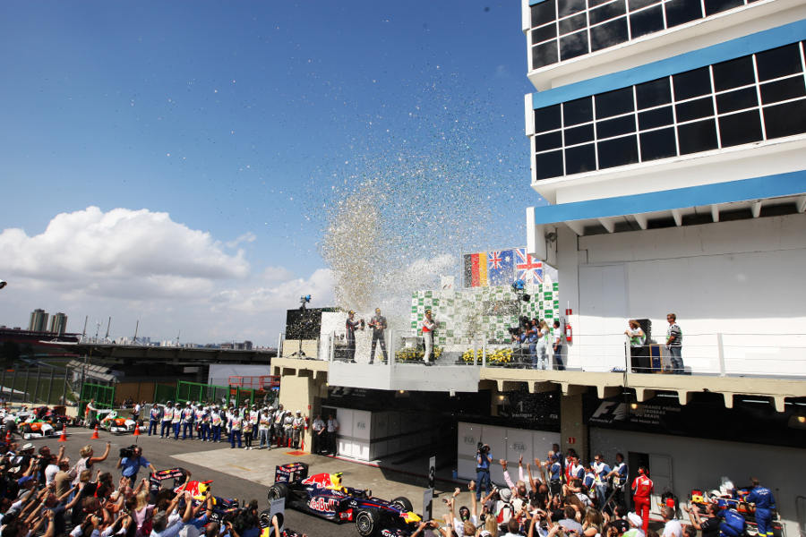 Mark Webber, Sebastian Vettel and Jenson Button spray the champagne on the podium