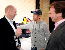 Sebastian Vettel chats with Adrian Newey and Christian Horner