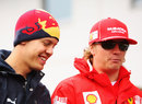 Sebastian Vettel and Kimi Raikkonen in the paddock