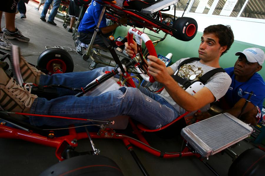 Jerome d'Ambrosio tries his kart for size at Felipe Massa's charity karting event