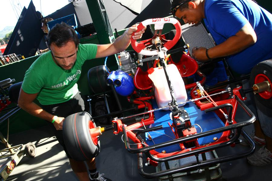 Tonio Liuzzi works on his kart at Felipe Massa's charity karting event